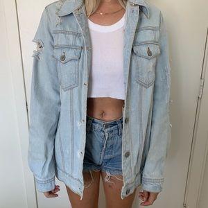 Light denim distressed jean jacket